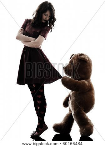 one caucasian strange young woman and vicious teddy bear in silhouette white background