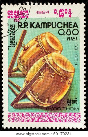 KAMPUCHEA-CIRCA 1984: A stamp printed in the Cambodia, shows a traditional musical instrument Skor thom, circa 1984