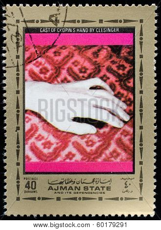 AJMAN - CIRCA 1972: A stamp printed in Ajman shows portrait of the great musician and composer Frederic Chopin plaster cast hand, circa 1972