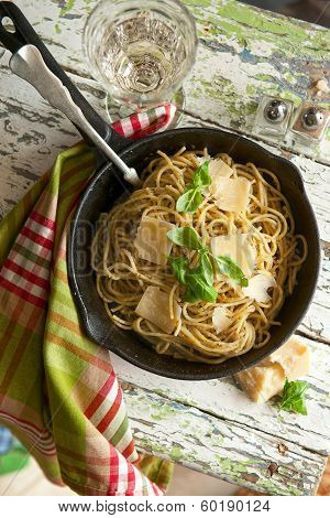 Pasta Spaghetti With Pesto Sauce On The Wooden Table