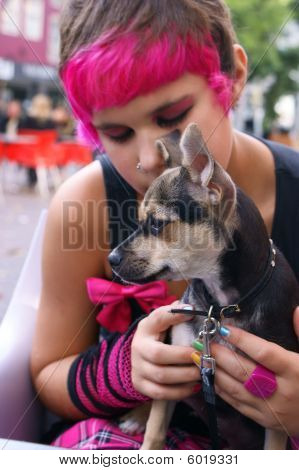 Trendy Girl Holding Dog