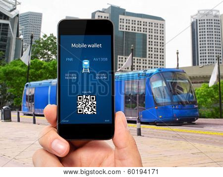 Man Hand Holding The Phone With A Mobile Wallet And Train Ticket Against The Blue Train To The City