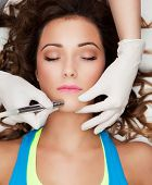 Woman getting laser face treatment in medical spa center, skin rejuvenation concept poster