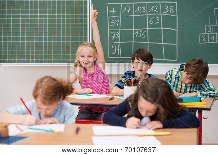 Intelligent Enthusiastic Little Girl In Class
