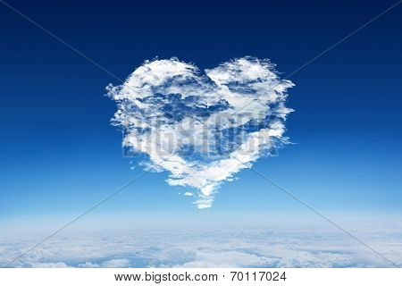 Cloud heart against blue sky over clouds at high altitude poster