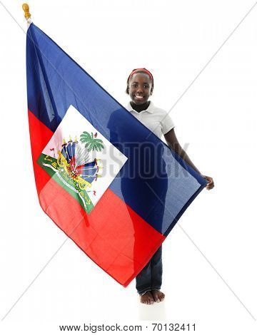 A pretty tween girl proudly holding her Haitian flag.  On a white background.