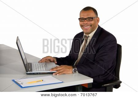 smiling mature businessman with laptop
