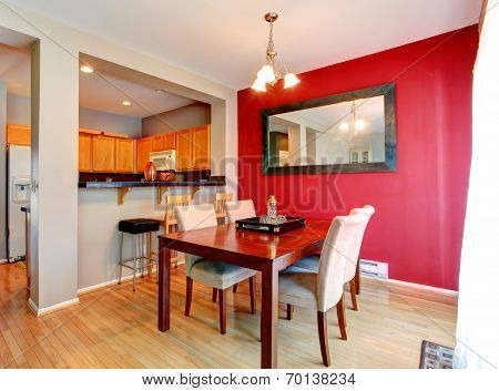 Dining Room With Contrast Red Wall