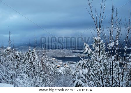 Aalesund city covered with snow. seen from the hill viewpoints at the North East side of the city. poster