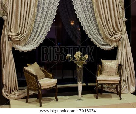 Luxurious Chairs And Window Curtains