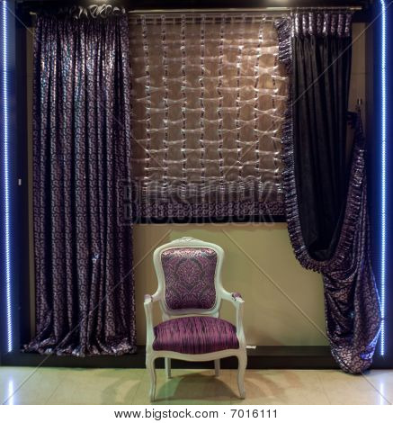 Luxurious Chair And Window Curtains