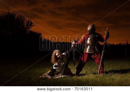 Medieval Knight Is Going To Make An Execution Of A Witch