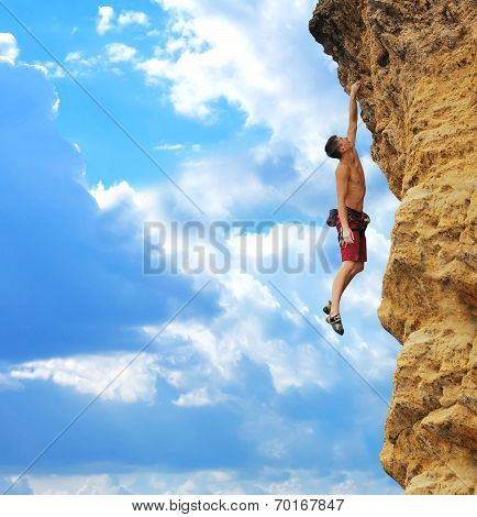 Guy Hanging On Rock