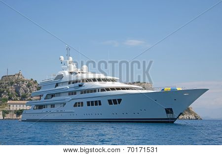 Luxury large super or mega motor yacht in the blue ocean. poster