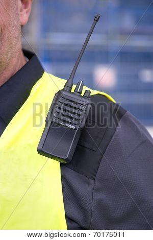 walkie-talkie on sholder of man i yellow vest poster