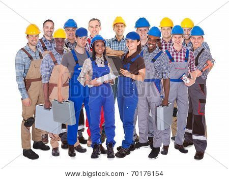 Confident Manual Workers Against White Background