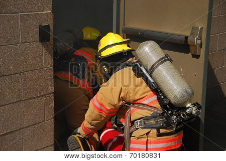 Fire fighers and smoke
