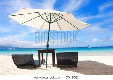 Chairs And Umbrella On Sand Beach