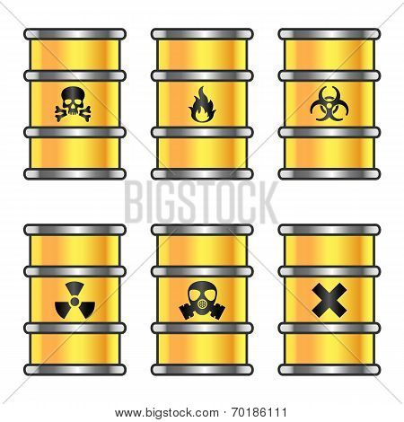 Yellow metallic barrels with warning signs