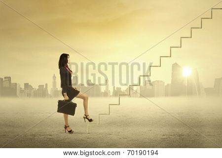 Businesswoman Step On Stair For Success
