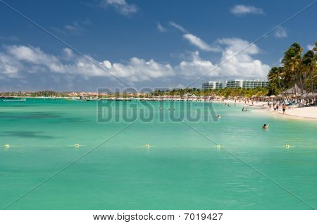 Vacationers Along Palm Beach In Aruba