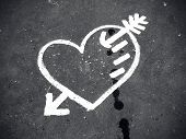 Abstract white heart painted on the dirty pavement poster