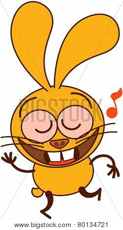 Cute yellow bunny dancing and singing animatedly