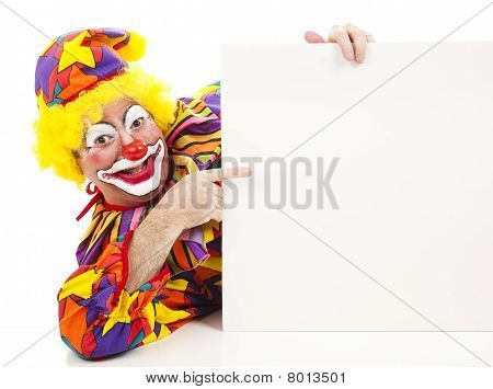 Cheerful Clown Points At Sign
