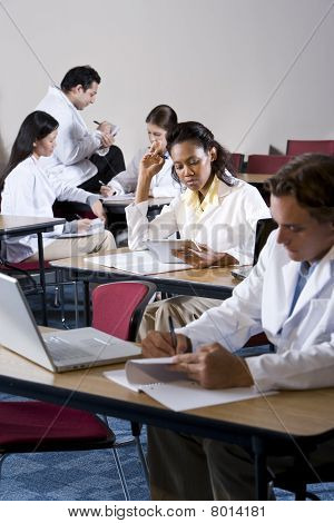 Multiracial Medical Students Studying In Classroom