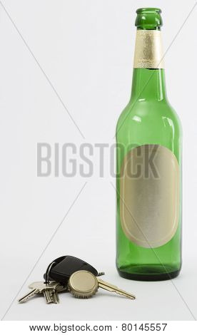 Empty Beer Bottle With Car Key And Crown Cork