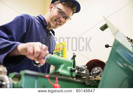 Engineering student using heavy machinery at the university