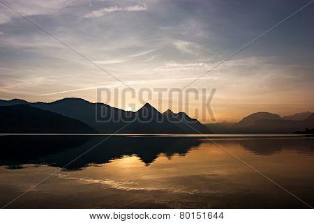 Lake Reflection At Sunrise