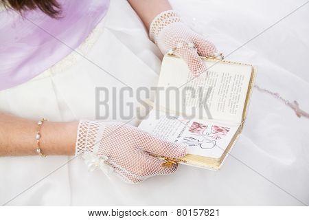Young Girl Reading Prayer Book