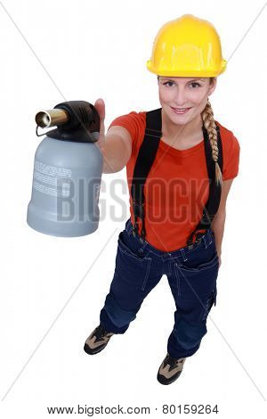 Blond woman holding blow torch