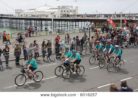 Cyclists Pass Brighton Pier