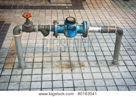 Main Water Line With Meter And Valve On Public Sidewalk