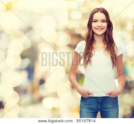 t-shirt design concept - smiling teenager in blank white t-shirt