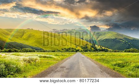 Abandoned Road Through Meadows In Mountain
