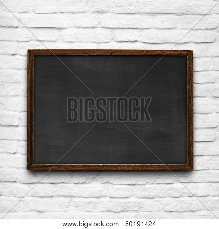 Chalkboard On White Brick Wall