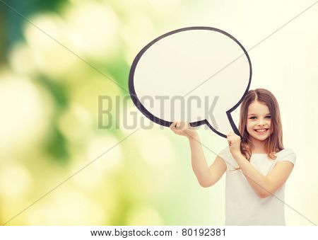 happiness, child, conversation and people concept - smiling little girl with blank text bubble