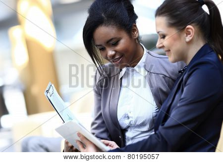 Businesswomen With documents and folder Sitting In Modern Office
