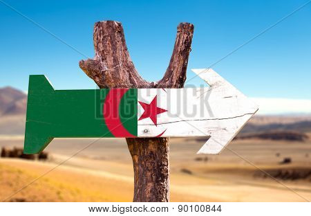 Algeria Flag wooden sign with dry background