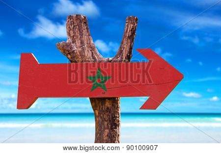 Marocco Flag wooden sign with ocean background