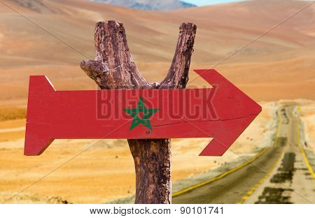Marocco Flag wooden sign with desert road background