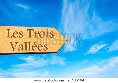 Wooden arrow sign pointing destination Les Trois Vallees, FRANCE poster