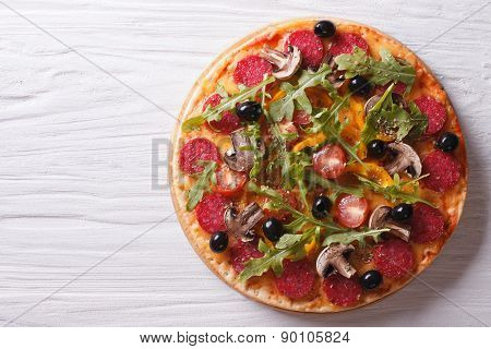 Hot Italian pizza with rucola and salami horizontal view from above poster