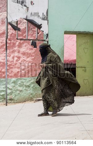 HARAR, ETHIOPIA-APRIL 17, 2015: An unidentified woman in traditional burka passes through Harar, Islam's fourth holiest city