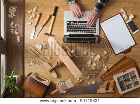 Man Working On A Diy Project With His Laptop