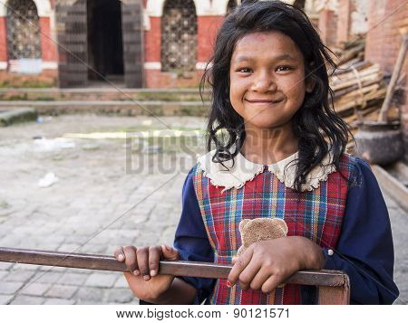 Sankhu, Nepal-oct 13 , 2012 : The Unidentified Girl Is Greeting People With Her Welcome And Naive Sm