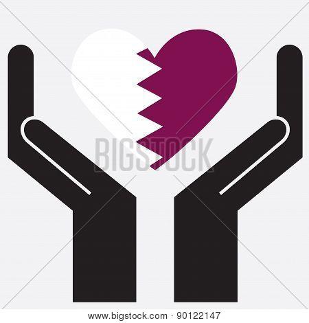 Hand showing Qatar flag in a heart shape.